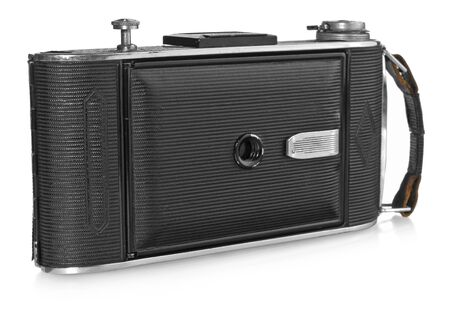 Old, antique pocket camera. Black camera closed with a black leather handle. View from the front of a white background with slight reflection. Camera model Agfa Billy Record.