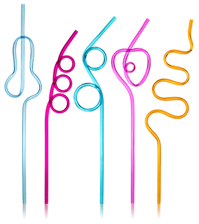semitransparent: Multi-colored semi-transparent in many shapes straw. Drinking straws in the colors blue, purple, pink, yellow on a white background with slight reflection.