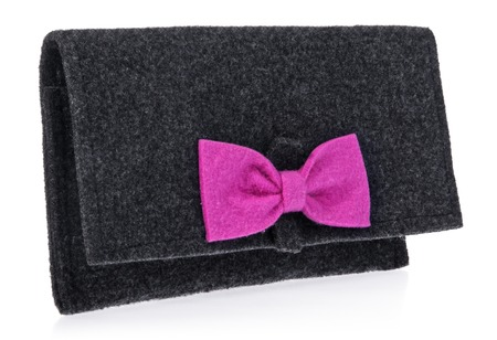 The felt, textile, womens handbag, purse with bow in black color, pink. Textile Bag trinkets on a white background.