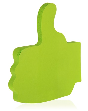 green sticky note stuck in the shape of a raised thumb like stock
