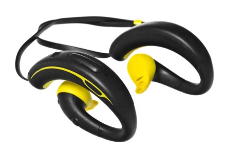 climatic: Waterproof headphones, earphones yellow and black. Headphones for running in the rain and sports on heavy climatic conditions. Accessory for athletes isolated on white background with light shadow and reflection.