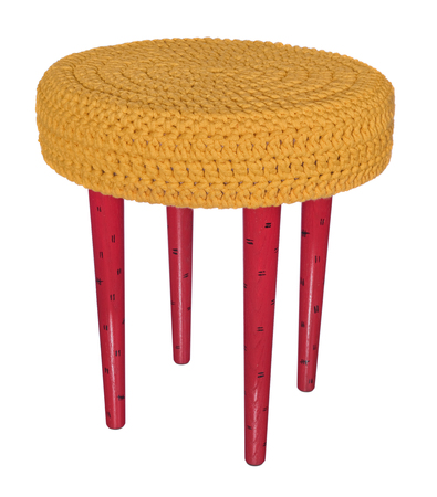 Handmade stool. Hand painted wooden chair legs red in black patterns.. Round seat covered with yellow, woolen material. Object isolated on a white background.