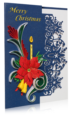 Handmade Christmas card. Postcard with Merry Christmas greetings. Hand decorated card with flower poinsettia, spurge similar, candle and bells. Paper decorations decorated with leaves and folkloric, folk patterns. Card in blue, gold, green, yellow on a white background with a slight reflection.