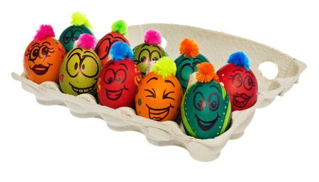 Easter eggs, hand-painted with smiling and terrified cartoon faces. Decorated eggs with funny colorful hairstyles put in a cardboard box, container for eggs. Figures on a white background.