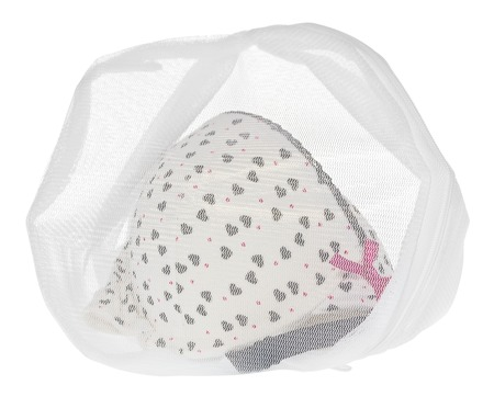 Wash bag for delicate clothes, shoes, underwear, bra. A laundry bag made of white mesh filled bras, isolated on a white background.