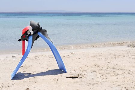 snorkelling: Snorkelling gear with the sardinian sea on the background