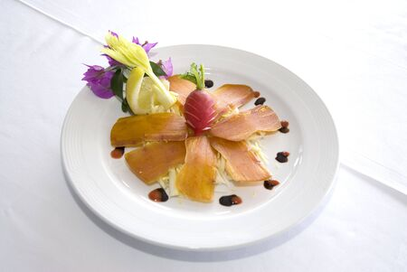 mullet: sardinian sliced bottarga served with celery and reddishes  Stock Photo