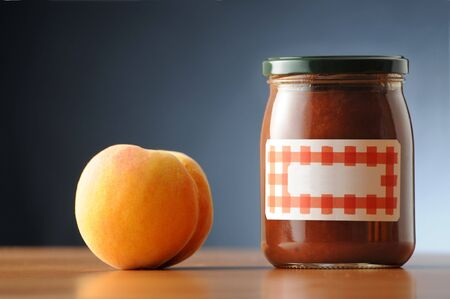 branded: peach jam  in a labelled and not branded can  Stock Photo