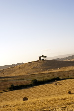 Hay Bales on a yellow field in the tuscany country at sunset Stock Photo - 6988995