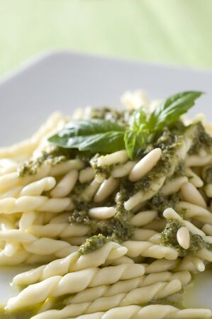 a typical italian dish  pasta al pesto sauce made with basil, garlic and pine nut photo