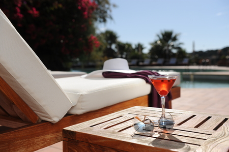 drink at the beach: soft drink in a beach chair by the pool of a luxury hotel Stock Photo