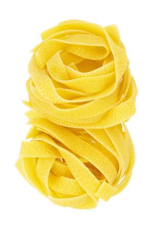 Italian pasta fettuccine nests isolated on white background. Pasta tagliatelle top view Standard-Bild