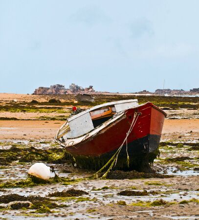 a boat on a low tide Stock Photo