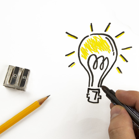 inventive: Bulb painted on paper with black marker