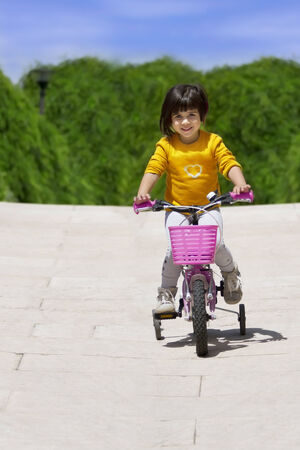 casters: little girl with her bicycle