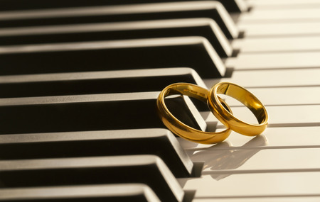 Wedding rings on piano photo