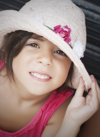 ojos cafes: Portrait of beautiful smiling little girl with brown eyes.