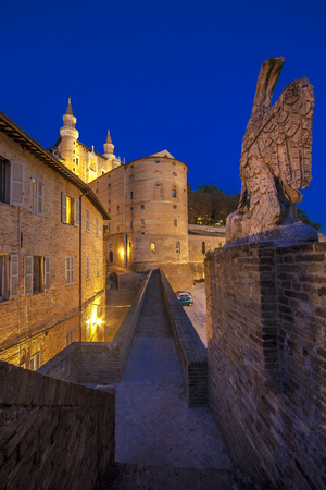 Narrow alley in the center of the city of Urbino in the evening Editorial