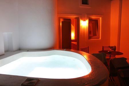 private Jacuzzi by night in oia Santorini