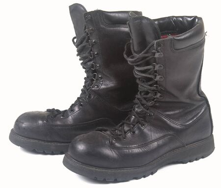 Military black leather boots on a white background photo