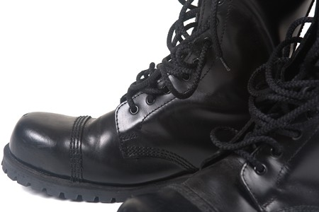 skinhead: steel toe black leather boots on white background