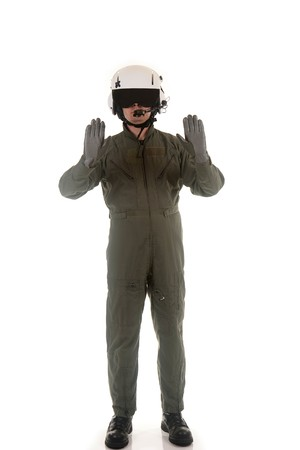 Military pilot with white helmet marshaling aircraft on a white background Stock Photo - 7275717