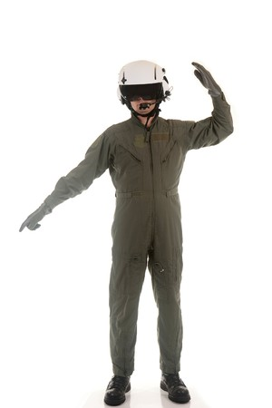 Military pilot with white helmet marshaling aircraft on a white background photo