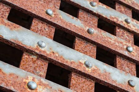 grate: Rusty grate of a well