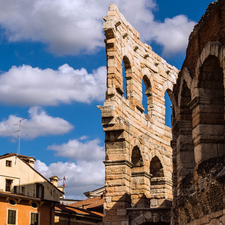a part of external wing of arena in Verona Italy. Shooted in a september noon with blue sky and white cloud Stock Photo
