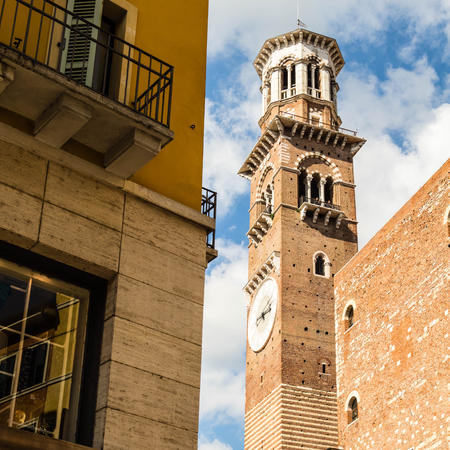 noon: Lamberti tower in Verona Italy. Shooted in a september noon with blue sky and white cloud i