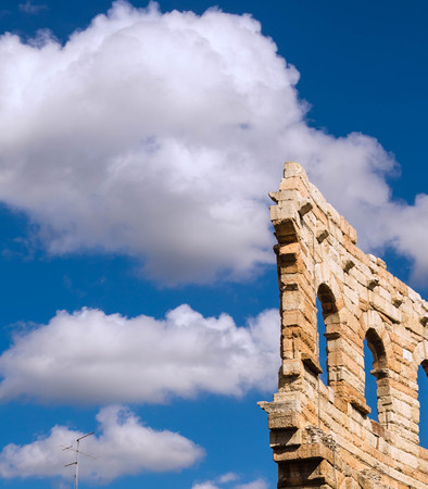 a part of external wing of arena in Verona Italy. Shooted in a september noon with blue sky and white cloud Editorial