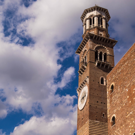 Lamberti tower in Verona Italy. Shooted in a september noon with blue sky and white cloud Editorial