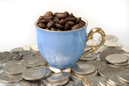 amongst: A cup of coffee beans amongst Swedish krona coins.
