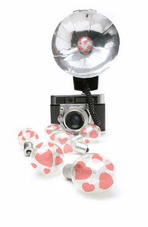 Valentine hearts on clear flash bulbs and old camera Imagens