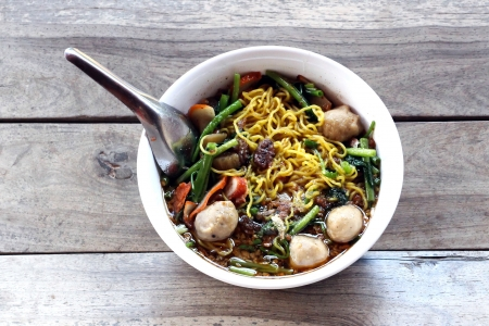 Spicy lemongrass flavored noodles soup with red pork photo