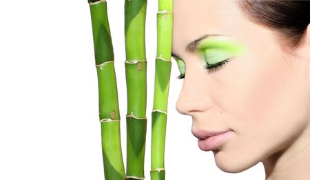 beautiful woman with bamboo against white background Stock Photo - 4627964