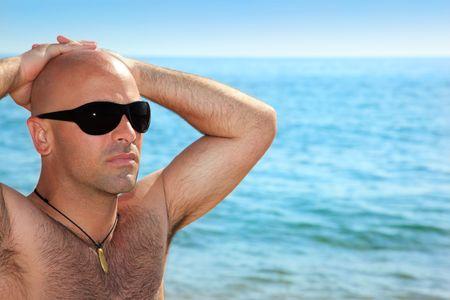 good looking man: Good looking man on the beach Stock Photo
