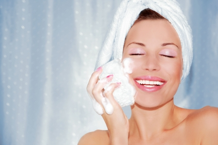 beautiful woman cleaning face. Beauty treatment photo