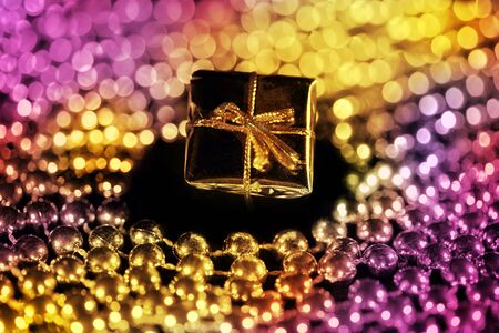 Gift box with shiny beads against black background Stock Photo - 5854607