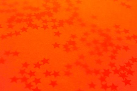 Old orange holiday wallpaper with a stars photo