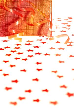 Gift box with stars against white background photo