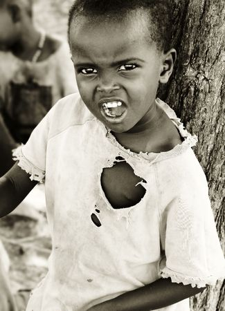 expressing: Portrait of African child expressing angryness. Editorial use only