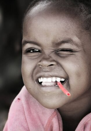 Portrait of African kid smiling. Editorial use only Stock Photo - 6890966