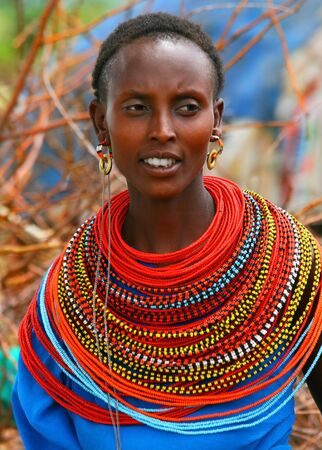 colorful beads: Portrait of a happy African lady.