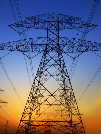 high voltage: Electricity Pylon against blue sky. Environmental damage Stock Photo