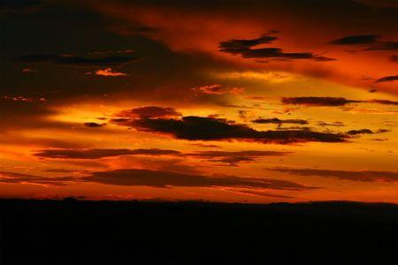 Dramatic sunset. Africa. Kenya. Masai Mara. photo