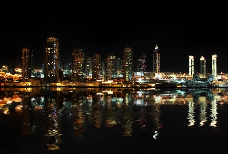 Dubai downtown at night reflected in water photo