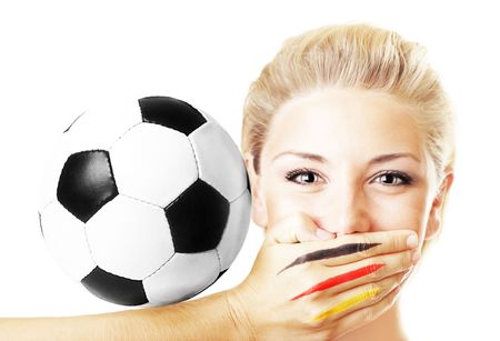 german girl: Portrait of a pretty football fan with ball isolated on white