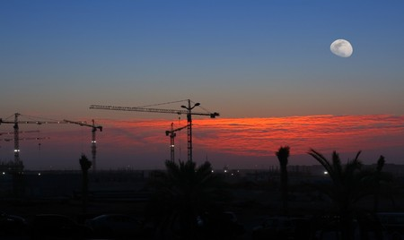 Cranes over sunset sky and moon Stock Photo - 7359215