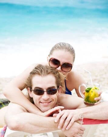 Happy young couple smiling on the beach photo